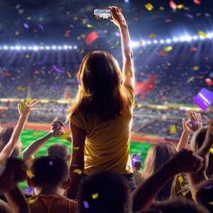 Learn how to market to sports' most avid fans: women.